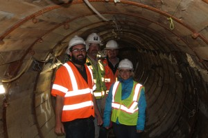 Robert, Will, Curt and Kym are inside the completed tunnel.